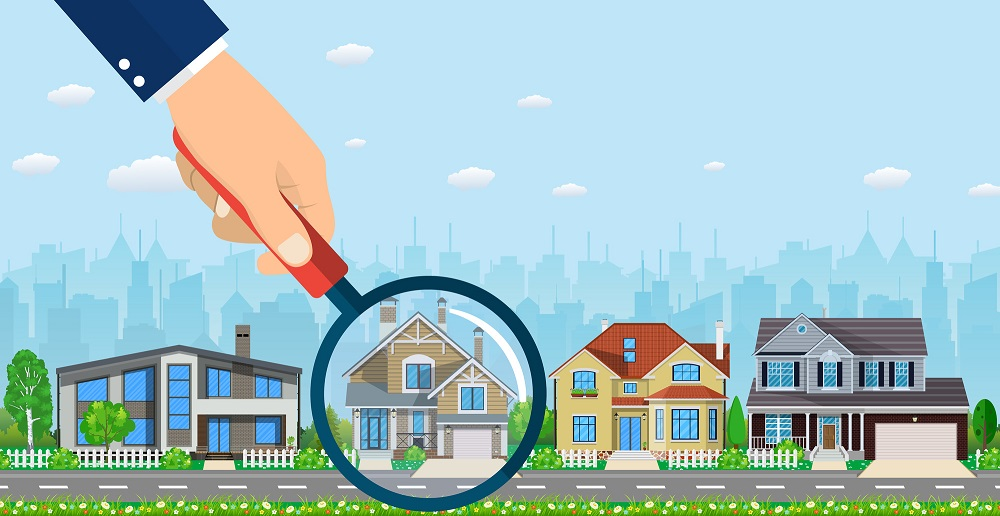 Magnifying glass with house.