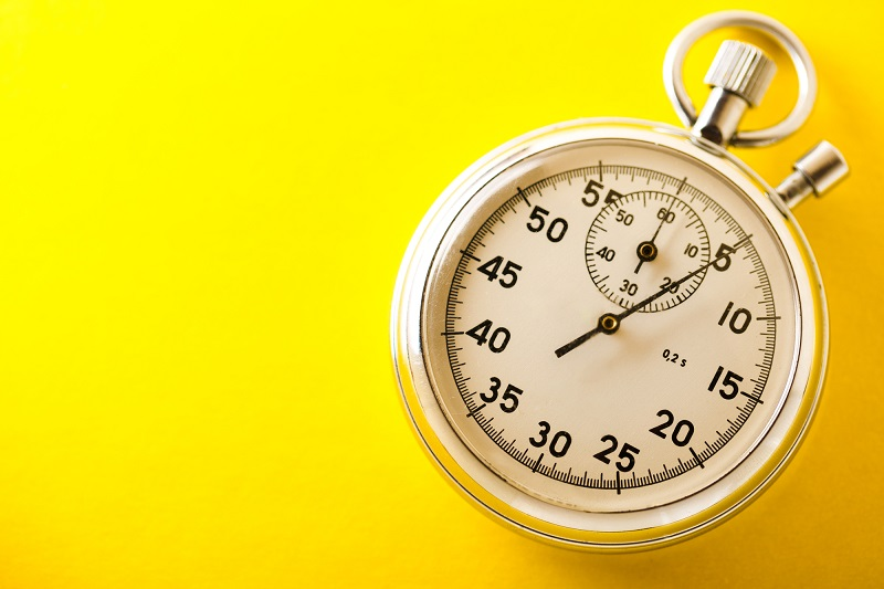 Stopwatch on yellow background
