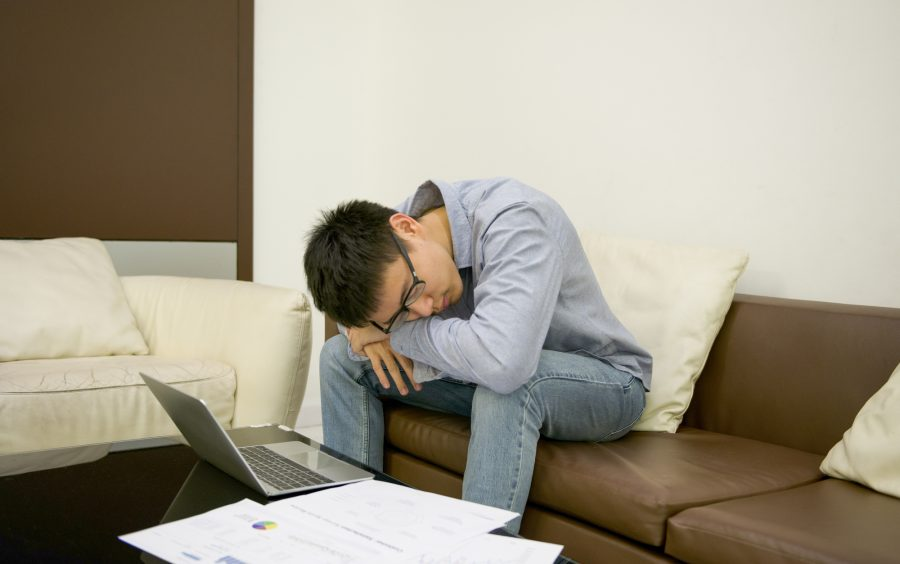 Asian businessman tired of work in living room